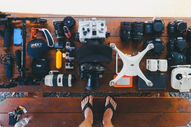Feet in flip-flops and a table full of video equipment