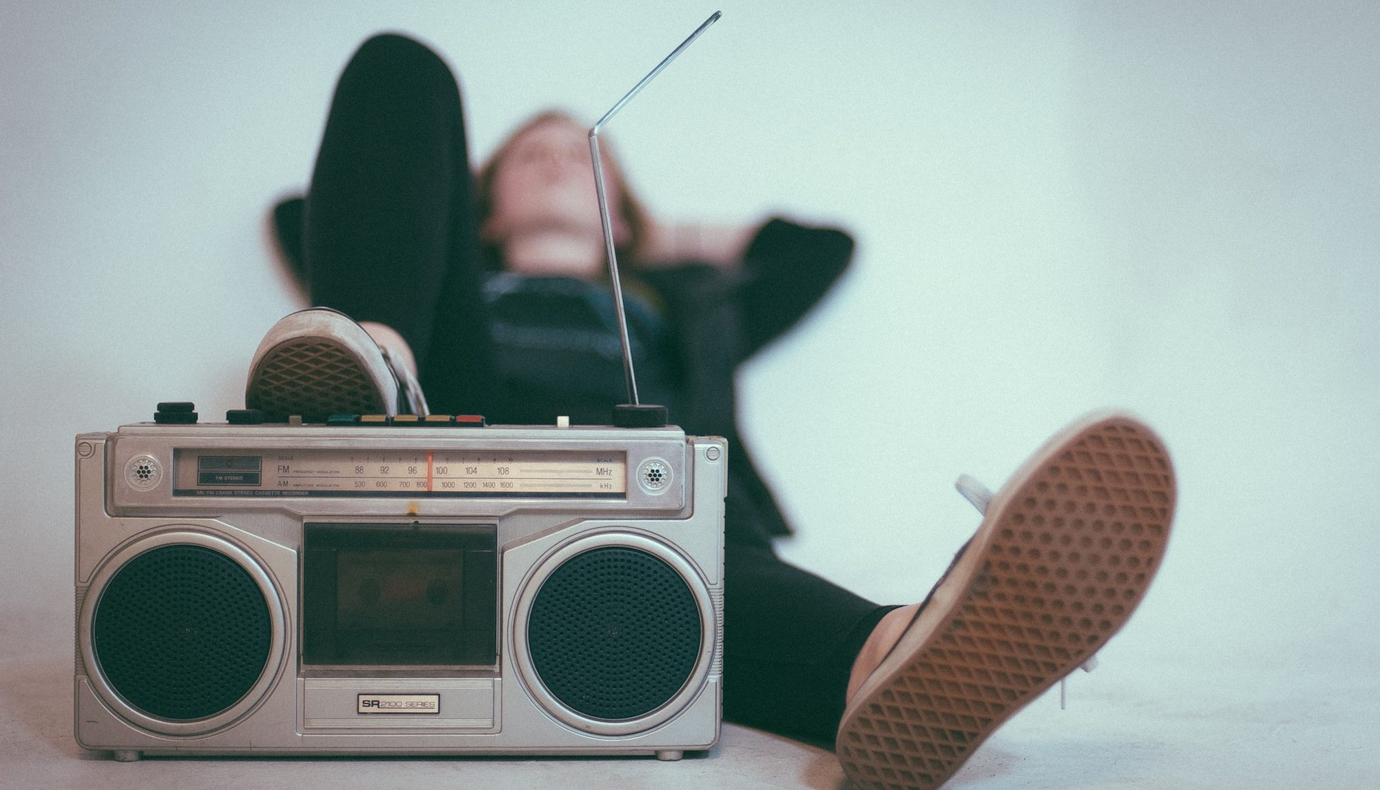 Cassette Player and someone laying on the floor – Apple Music Try&Buy